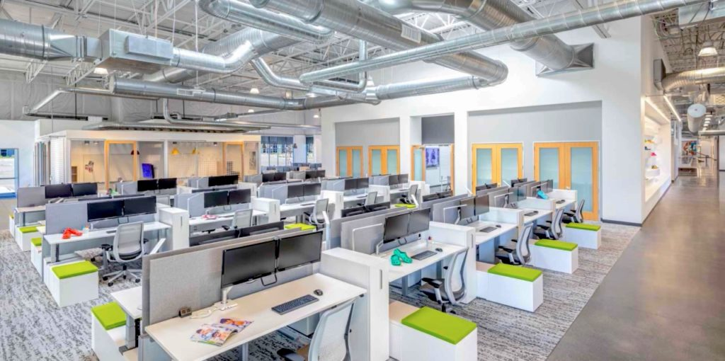 Wide view of Crocs office space in Broomfield with staff desks